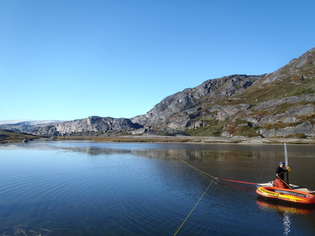 Gaylen Sinclair on the lake coring platform in South Greenland.