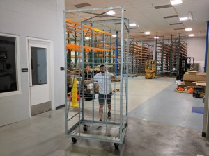 Ben moving one of the new u-channel racks in the new OSU-MGR.