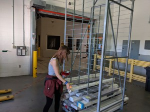 Katharine keeping inventory of all the boxes that have been moved.